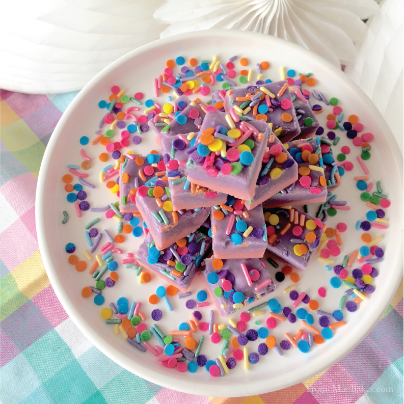 This easy to make White Chocolate Almond Flavored Unicorn Fudge Recipe is the perfect treat for birthday parties! www.froniemaebakes.com
