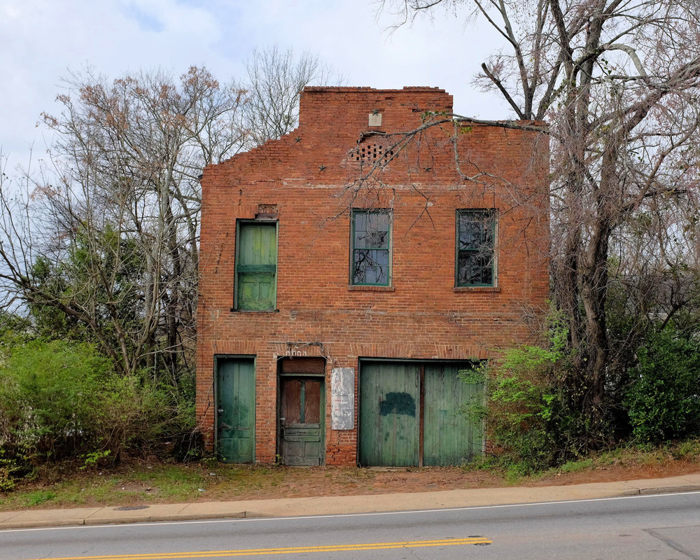 This building is actually on the edge of downtown Athens, and  Oconee Street, the road in front of it is heavily traveled. Athens is like that in many places: the old and decrepit juxtaposed with the brand new.