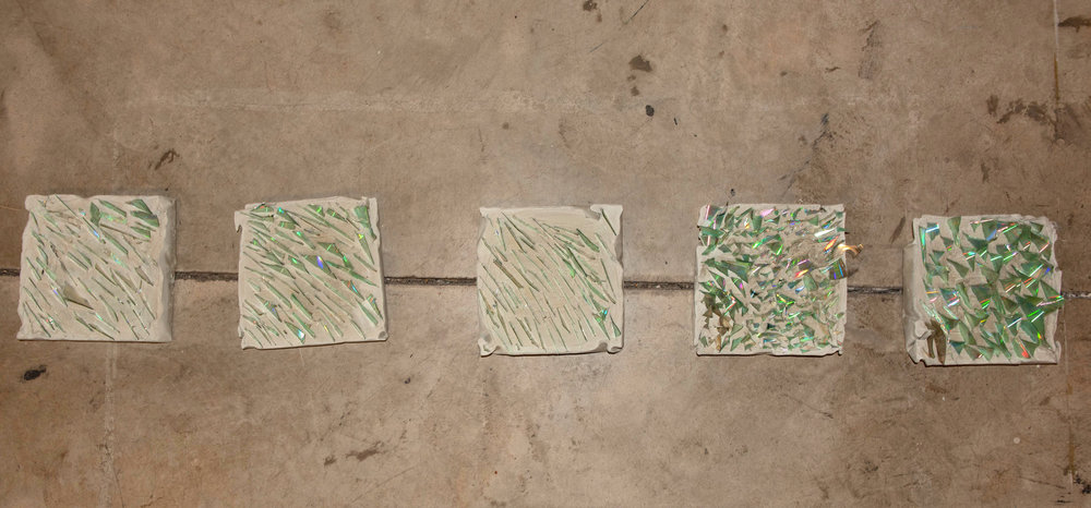 Glass Foot  Megan Burchett and Maddie Zerkel   Minneapolis, MN Cement with broken CDs 2018 $100 each