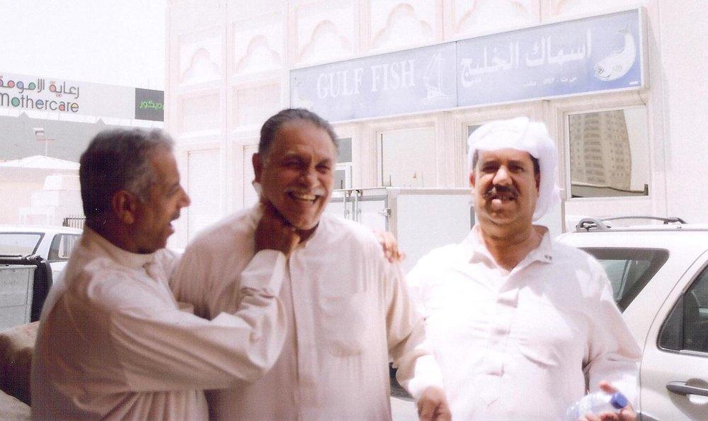 Manama, Bahrain.Bahrainis joking around at the Fruit and Vegetable Market. Photo: Hebah Fisher