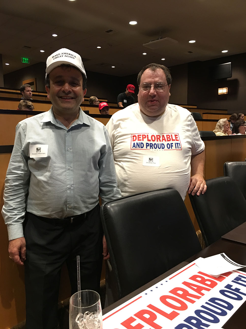 """Seattle, Washington: September 26 2016: Hosssein Khorram (L)a fundraiser for Trump Victory Inc poses for a portrait with a Trump supporter at the Seattle Republican viewing party for the first presidential debate. The man on the right is wearing a shirt that references a Hillary Clinton comment in September, """"you can put half of Trump supporters in what I call the basket of deplorables. The racists, sexists, homophobic, Islamaphobic."""" Photo: Hebah Fisher"""