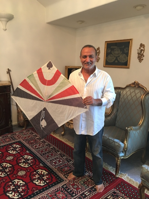 Basir Beria with one of his handmade kites, a traditional Afghani fighter kite.
