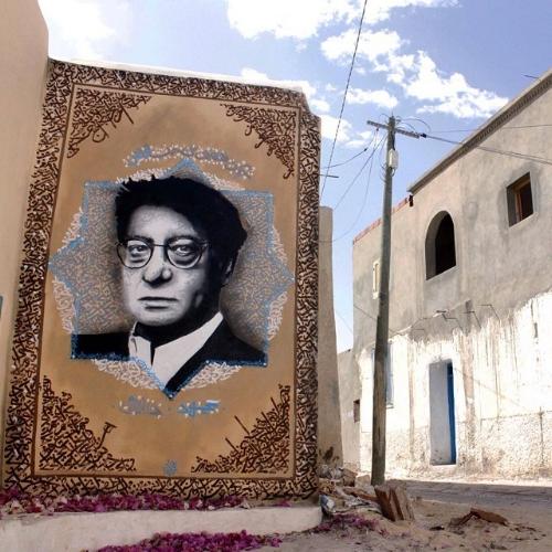 "Photo Credit:@yazanhalwani""Mahmoud Darwish""@djerbahoodproject painted in Djerba, Tunisia."