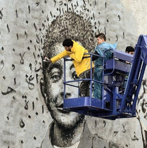 "Photo Credit:   @yazanhalwani   painting Fares, ""The Flower Salesman"" in Dortmund, Germany."
