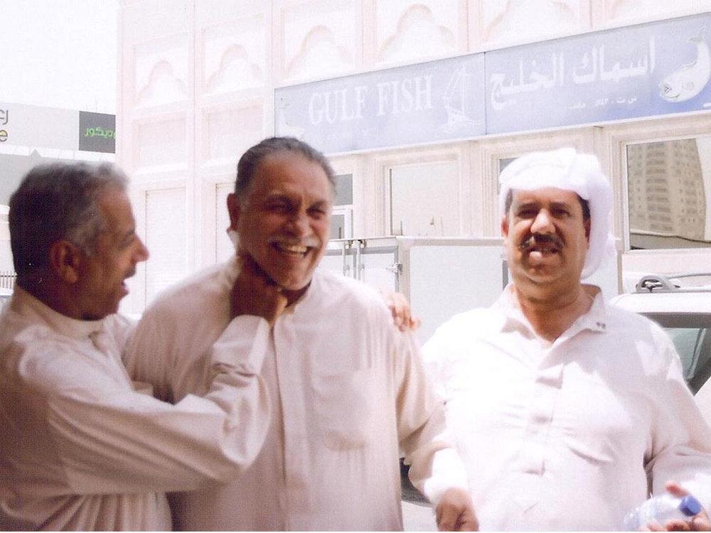 Manama, Bahrain. Bahrainis joking around at the Fruit and Vegetable Market