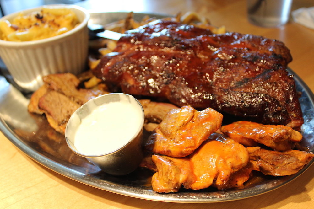 Ribs, Brisket, and Buffalo Chicken Thighs (sorry for the blur. Anna was trying her hand at photography...)
