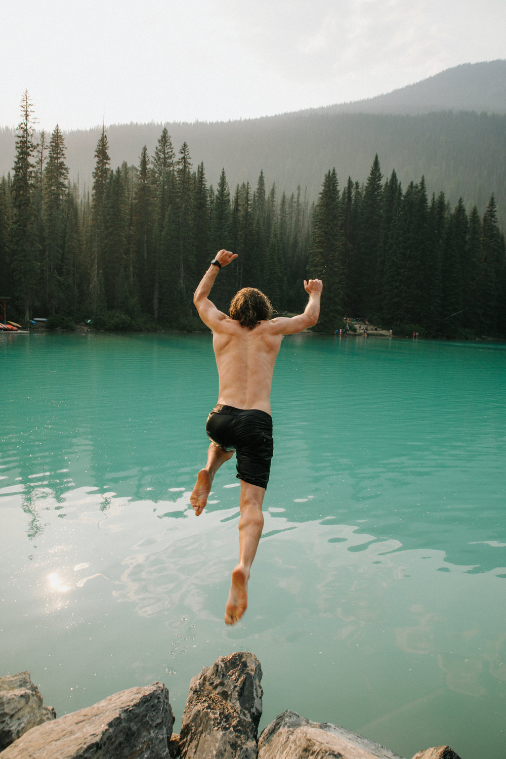 Emerald Lake. Crazy boy just jumps right in!