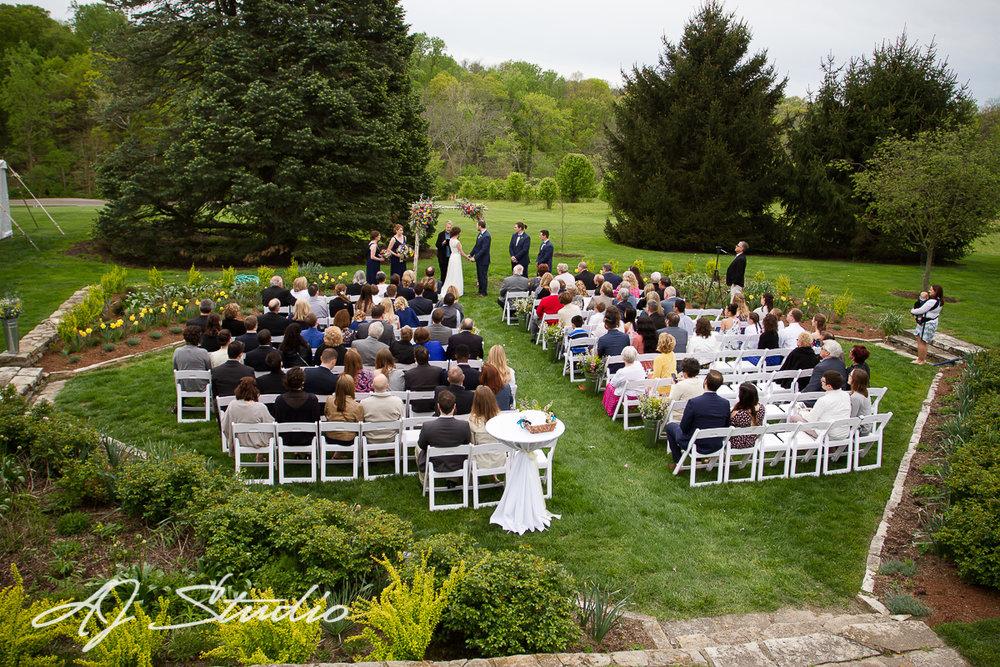 Outdoor wedding ceremony by AJ Studio