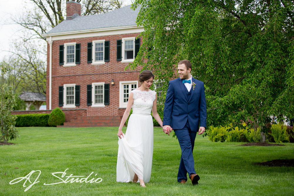 Bride and Groom standing in front of The French House