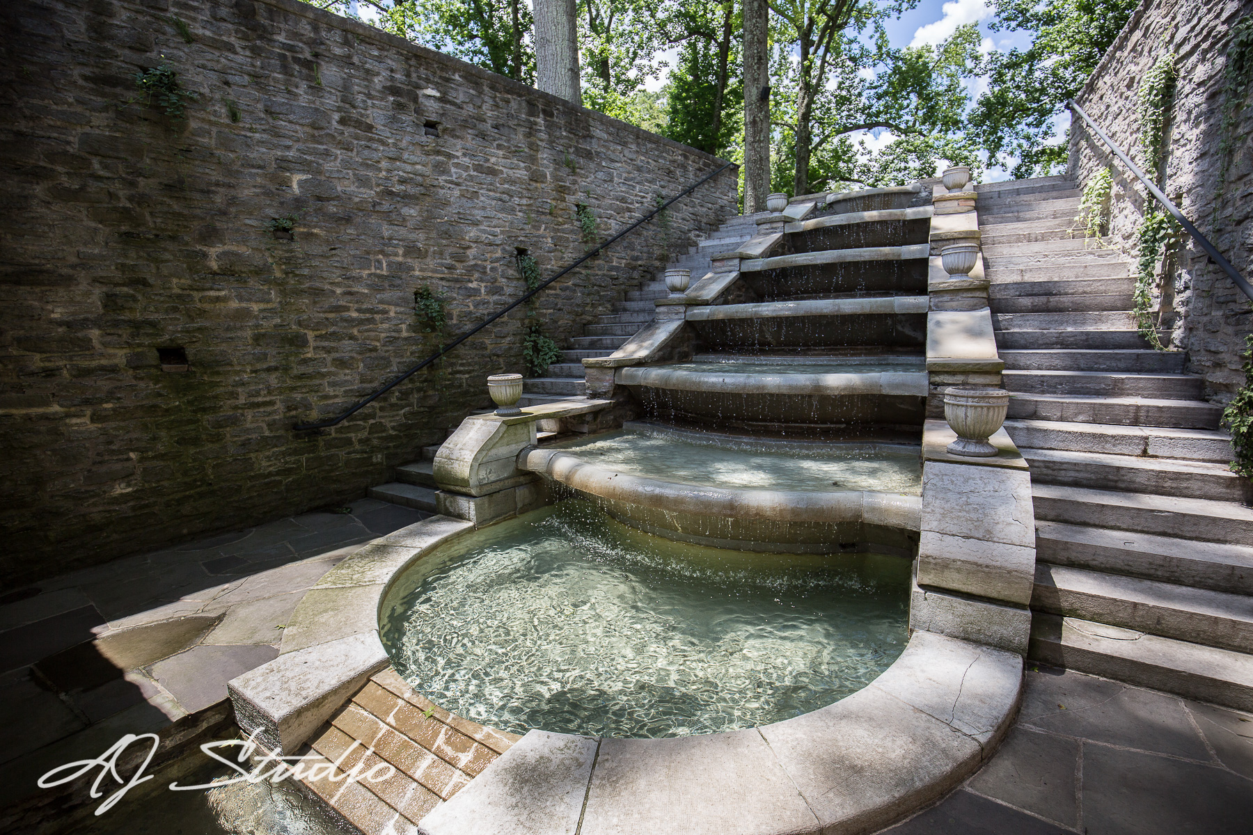 One of our favorite attractions at Greenacres is this elegant stone fountain called the 'cascading fountain', pictured above and below. Just to walk by the water as it gently trickles down each stone brings you peace and a sense of calm.