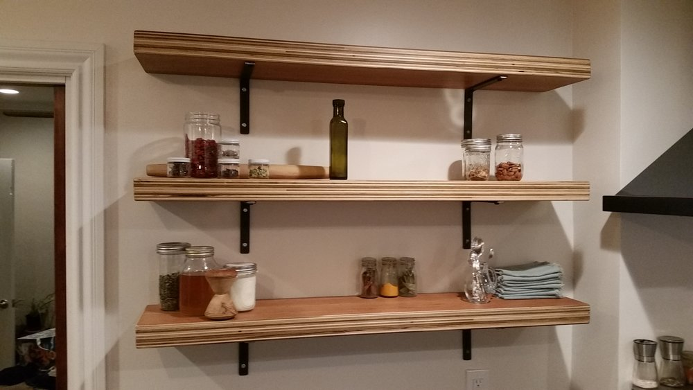 Cherry plywood kitchen shelves.