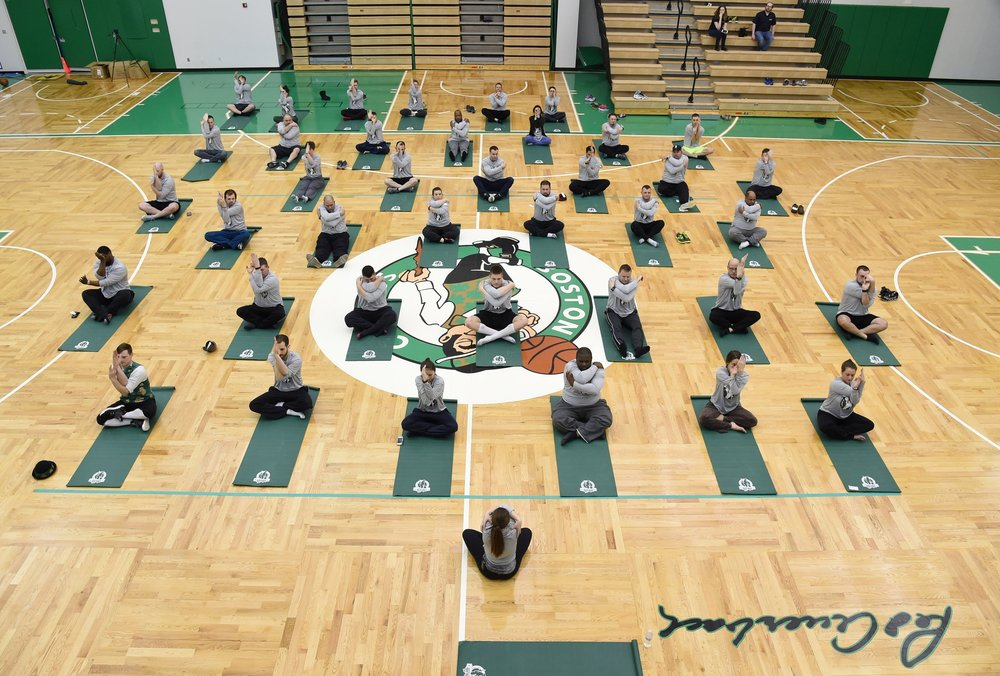 Ali teaching a class for the Boston Celtics' SNHU program on the team's practice court.