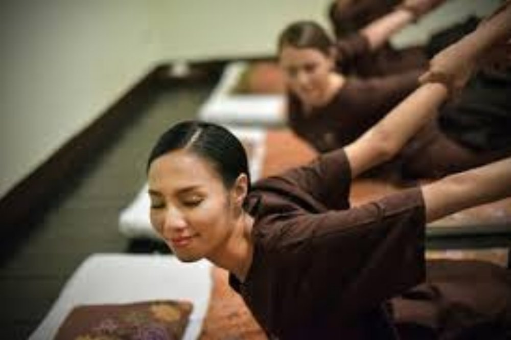 Stretching and yoga asana positions with correct breathing is part of Traditional Thai Massage.