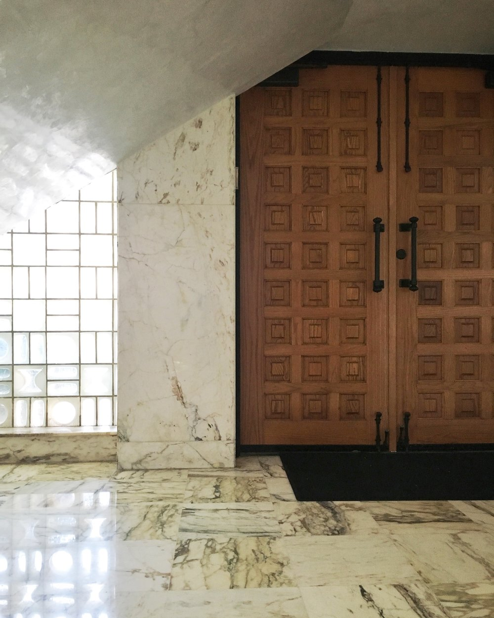 ELV's front door faces Washington Avenue and opens into the marbled foyer.