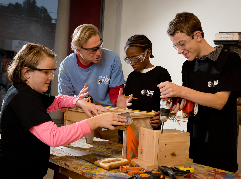 Kids Making It  (KMI) focuses on woodworking mentoring programs for at-risk youth. Their mission is to reduce juvenile delinquency and help all youth served stay in school, graduate, and transition successfully into college or the workplace as responsible adults.