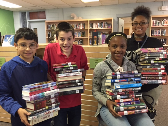 Noble Middle School  students enjoying their new library books.
