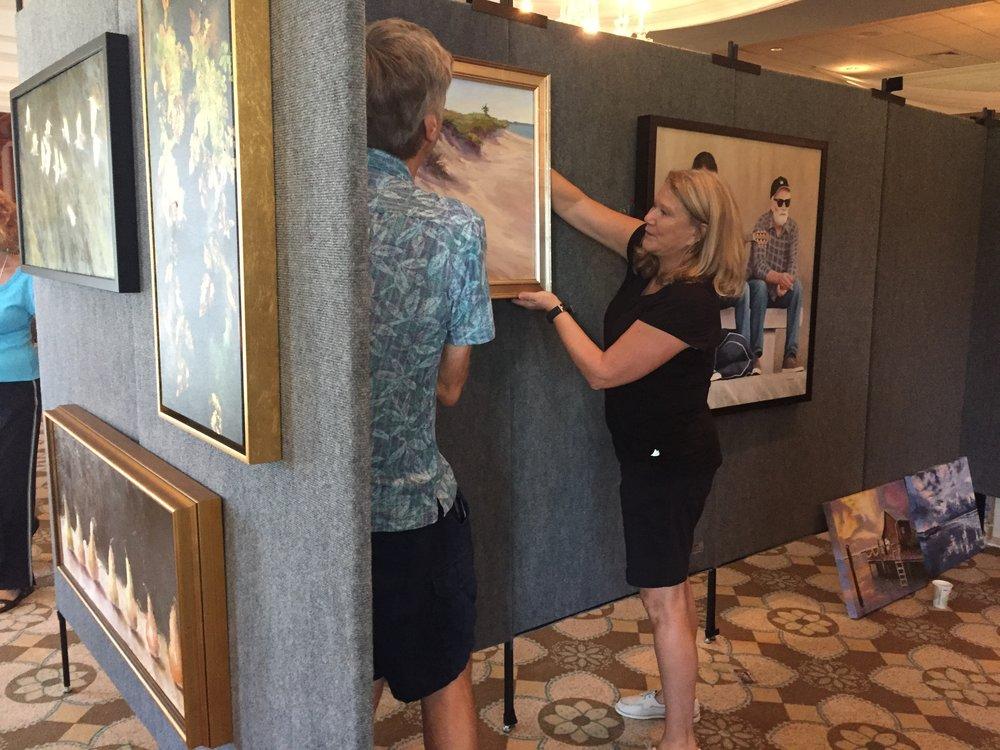 Art Show-hanging art.jpeg