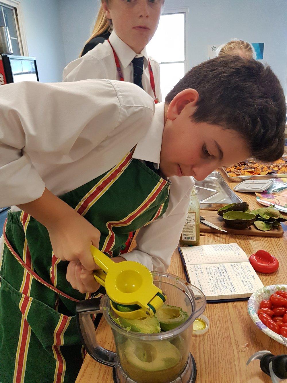 Nicholas squeezes a lime.jpg