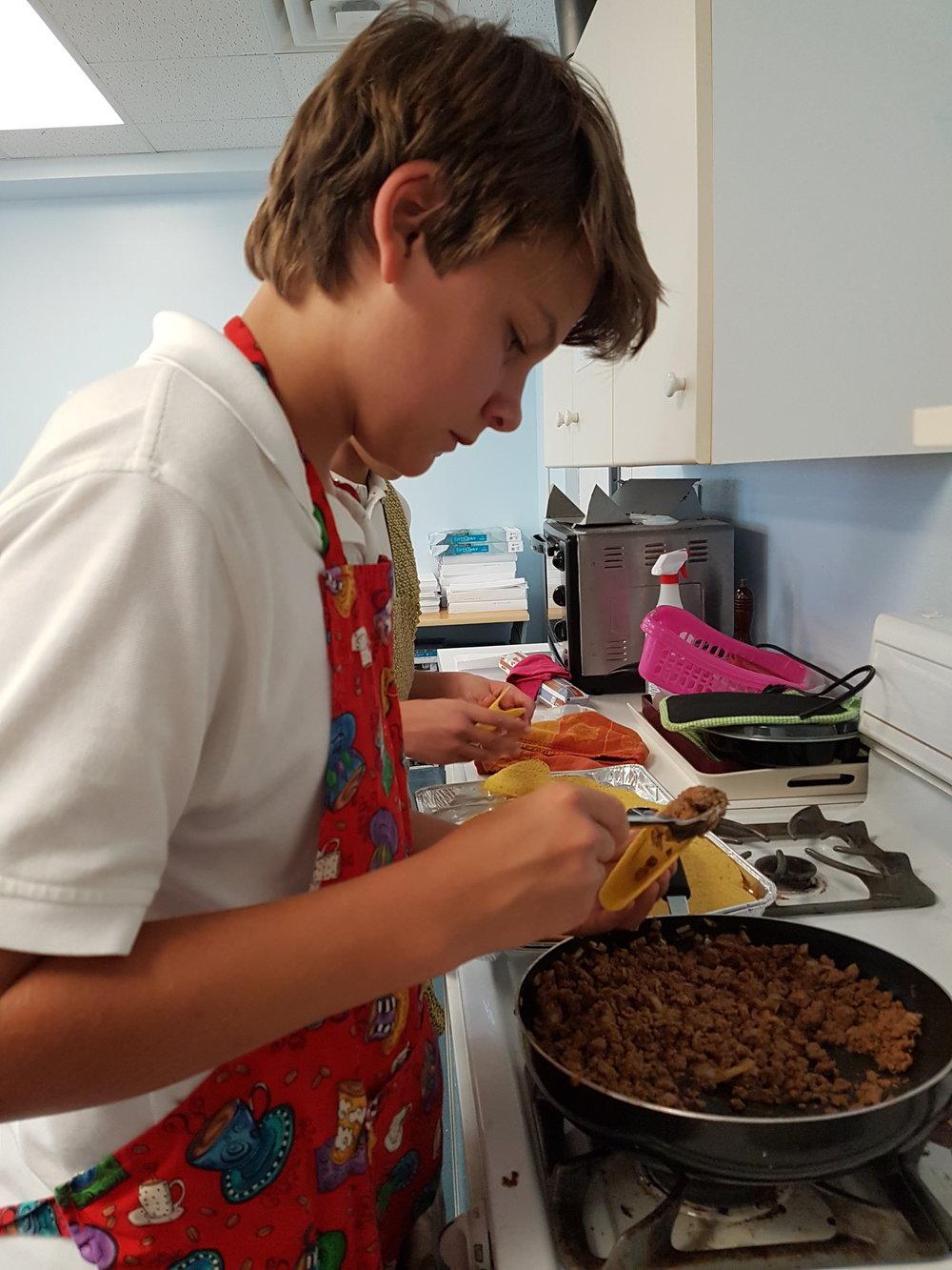 Bradley filling taco shells.jpg