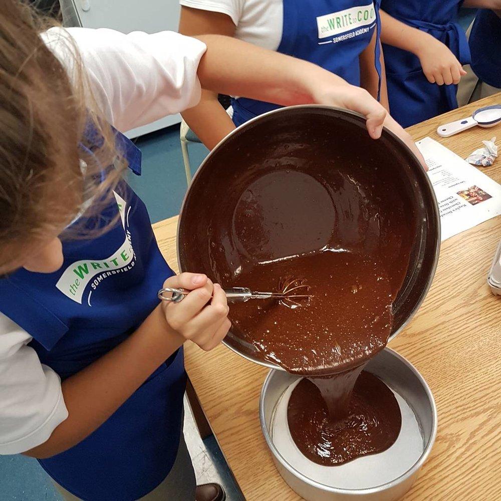Adrianna pouring cake.jpg