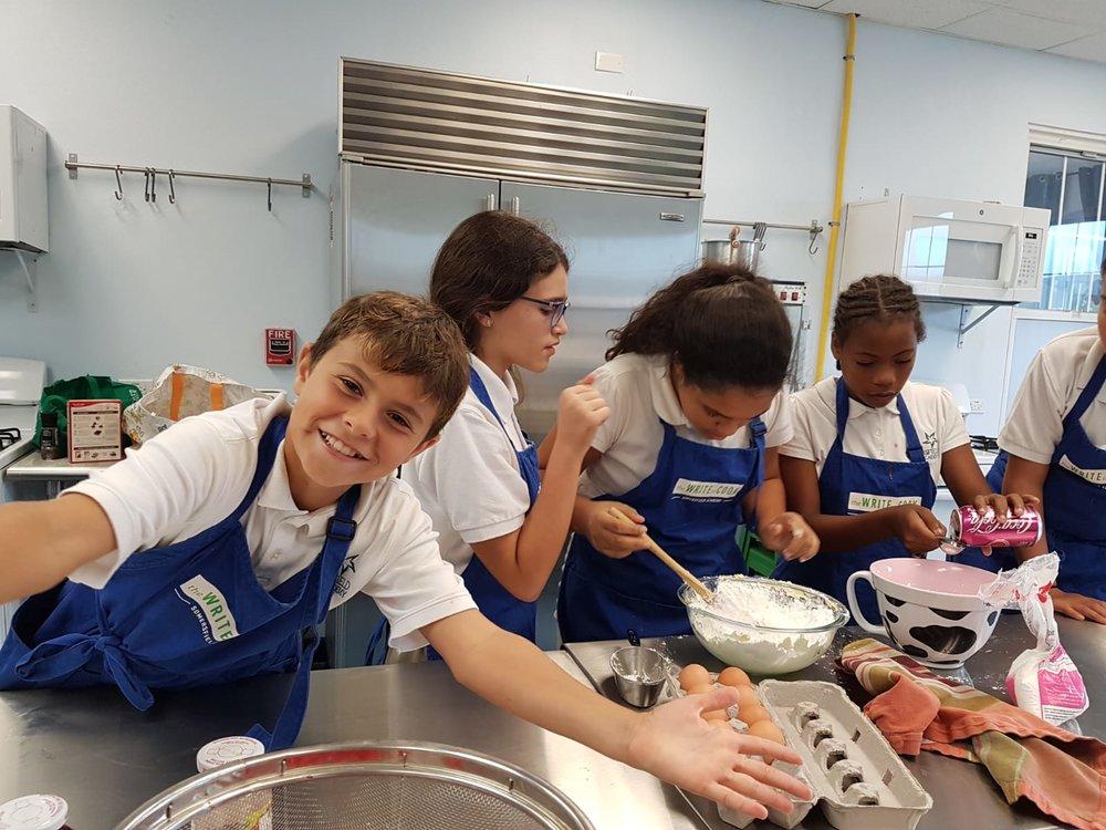 group mixing up cupcakes.jpeg