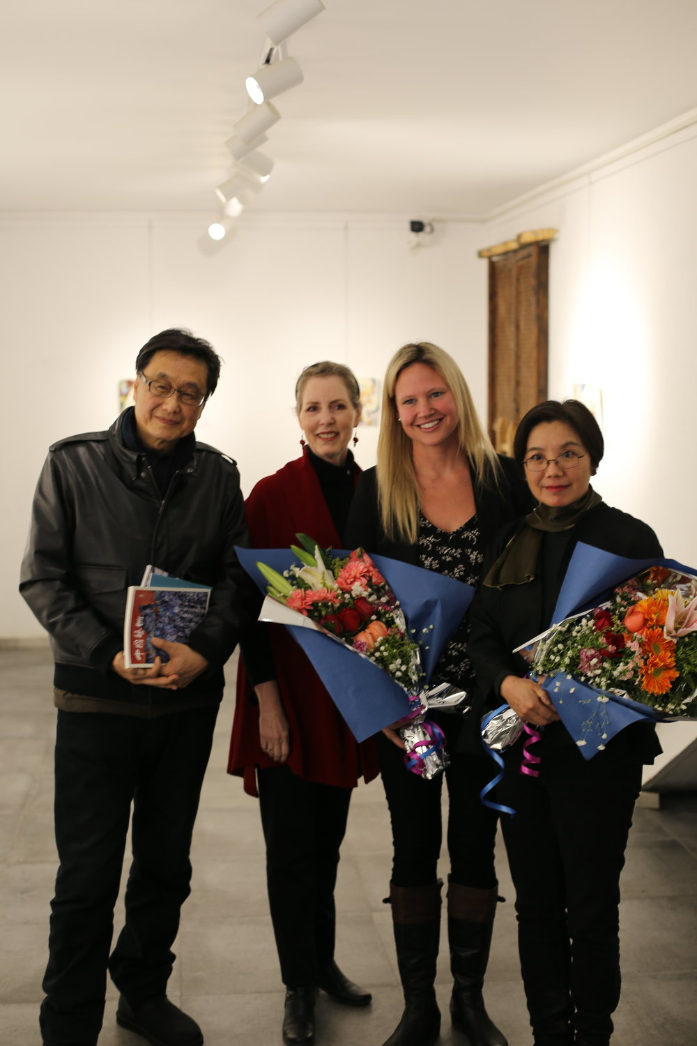 The curator with artists and professor