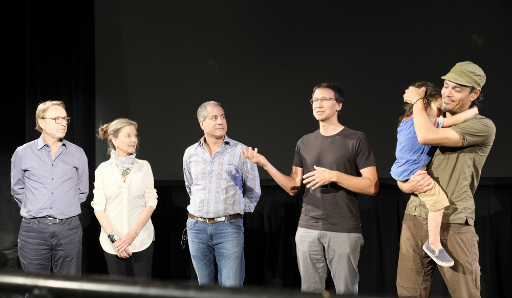 Brad Kremer, 4th from left, discusses his filmmaking process at SCFF 2017. To his right (with child) is Earthscape Artist Andres Amador, lead actor/subject of the film.