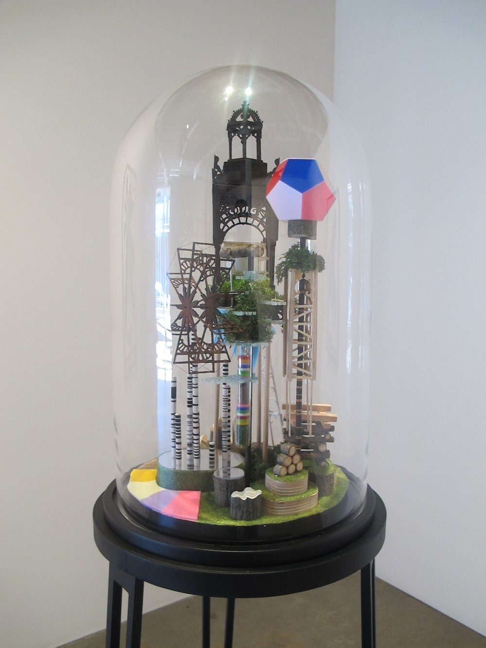 Simon MacEwan,  The works of industry of all nations , 2011, steel, wood, perspex, foam, wood veneer, lichen, model grass, ping pong ball, glass dome, 160 x 40 x 40cm