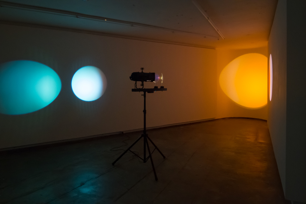 Michaela Gleave,  Eclipse Machine (Magenta, Orange) , 2015 Theatre lamp, dichroic filters, motors, powder coated aluminium, stand Installation view: Firstdraft Gallery, as part of the exhibition As if light could be translated, curated by Art Proper (Annika Kristensen and Samantha Willams).