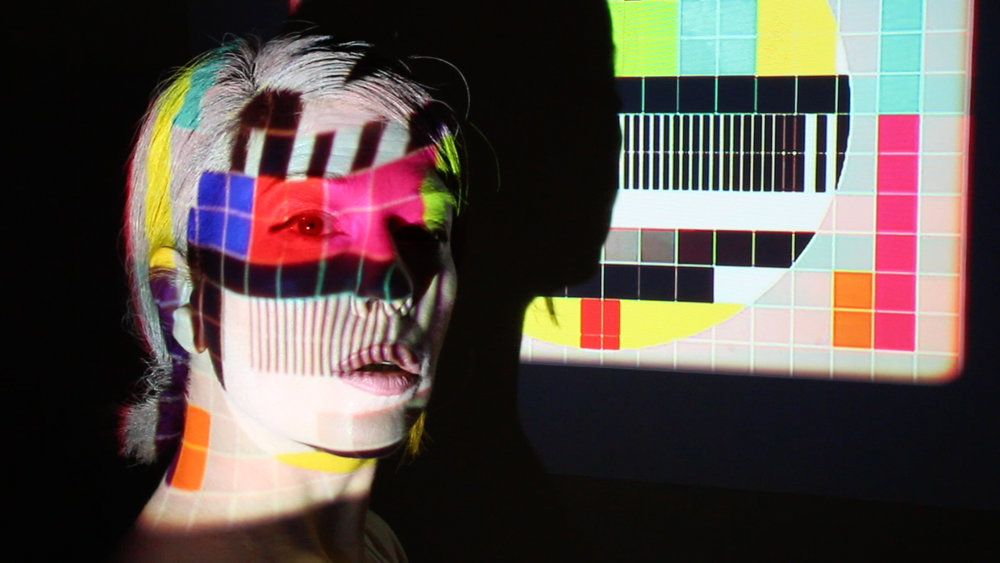 Sue Dodd,  Test Pattern 2 , Filming the people, video production still, digital print, 73 x 43cm