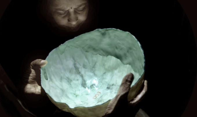 Elisabeth Weissensteiner, Mirror Brain, 2011, projected animation, polyester resin, fibreglass, pigment, 35cm diameter