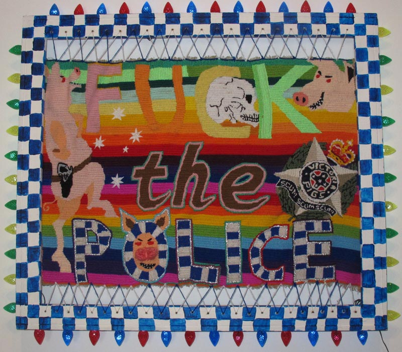 Paul Yore,  Fuck the Police , 2012 tapestry, wood, acrylic, lights, 67 x 79cm