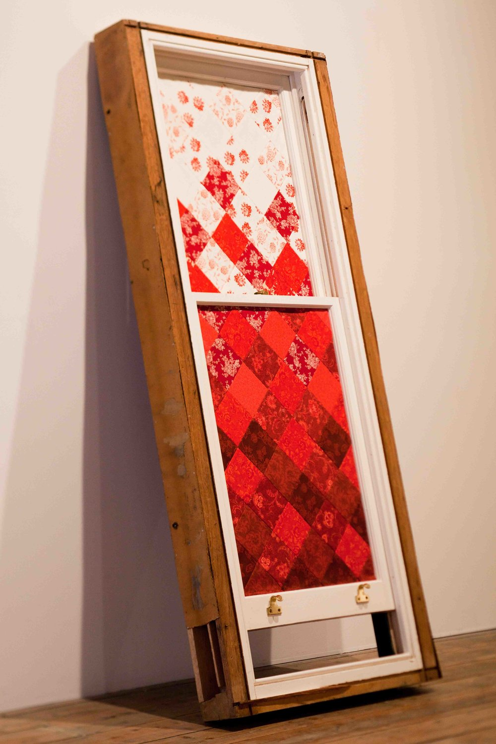 Julia Robinson,  Tint in crimson , 2011 (side view), window, fabric, thread, fixings, 1800 x 80 x 15cm