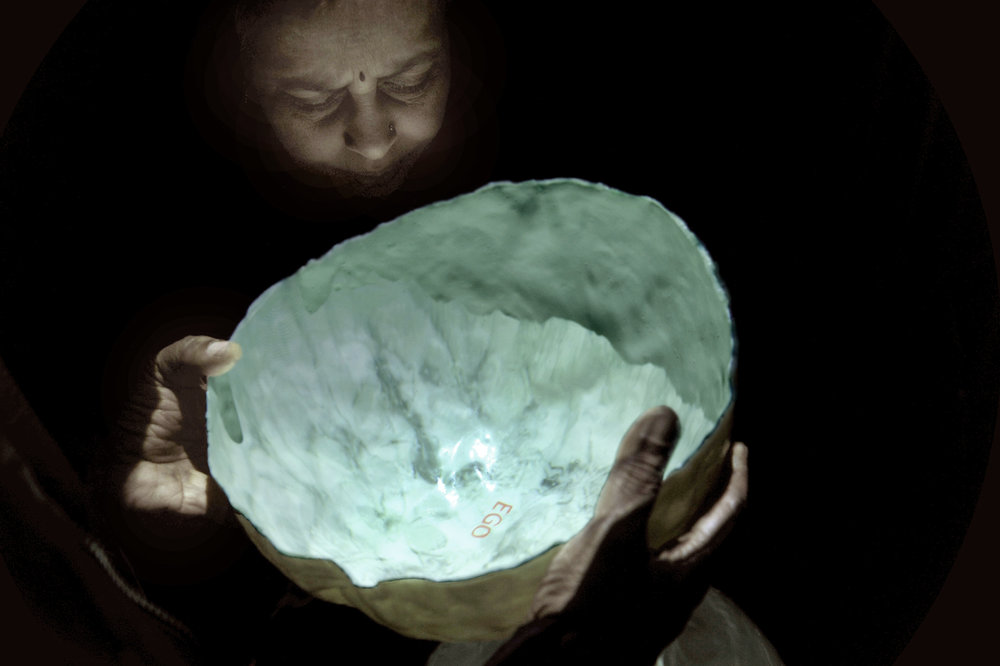 Elisabeth Weissensteiner,  Mirror Brain , 2011, projected animation, polyester resin, fibreglass, pigment, 35cm diameter