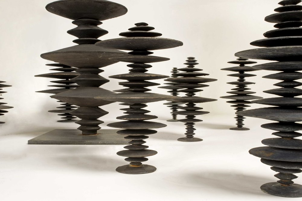 Ewen Coates,  Satori Discs , 2011, cast bronze discs, dimensions variable