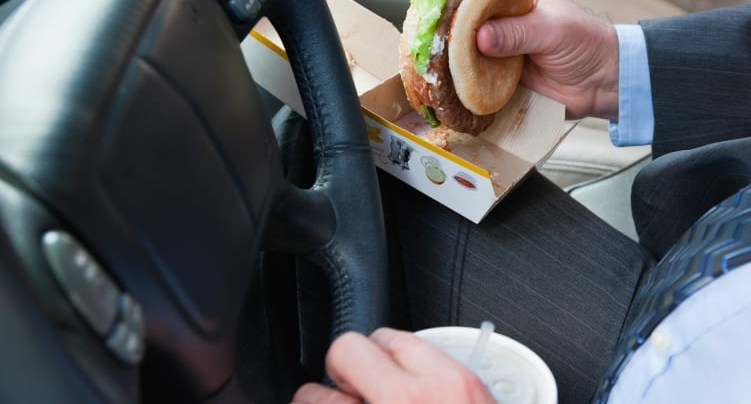 Eating while you drive is dangerous and messy. Keep a napkin handy...