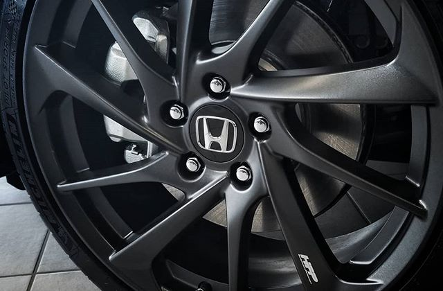 "The new Honda Civic Si with the HFP kit has arrived. Available in both sedan and couple options this time. 19"" matte alloys, side skirt and front lip spoiler, the classic red Si floor mats, HFP badging, a tuned suspension and a whole lot of fun."