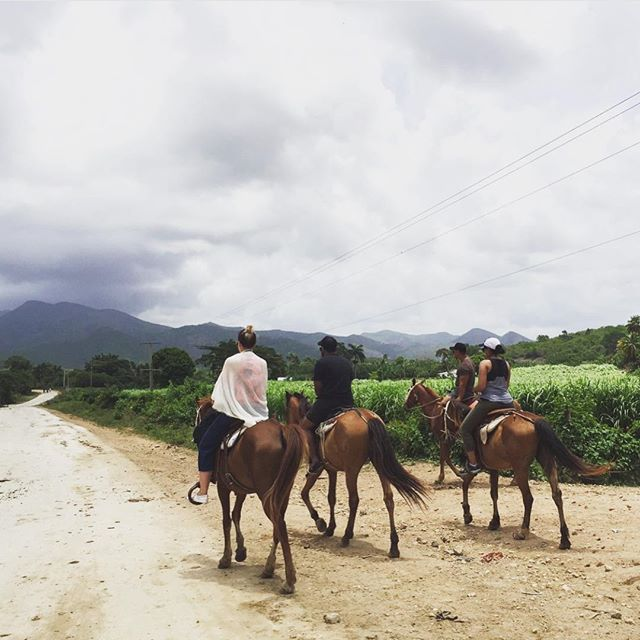 Caravaners horseback riding in the back country of Trinidad, Cuba. What was waiting for us at the end of the 2 hour ride?  A stunning waterfall waiting for us to jump in 💦🏞