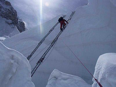 Ladders are necessary to cross the ice field to climb blocks and cross crevasses, as seen in this photograph by Olaf Rieck