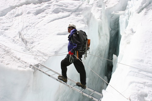 Pem Dorjee Sherpa uses a ladder to cross one of the many crevices at Khumbu Ice Falls.  Ladders and crampons will make for a difficult combination for all of us.  They will be particularly challenging for Hari on his stubbies.