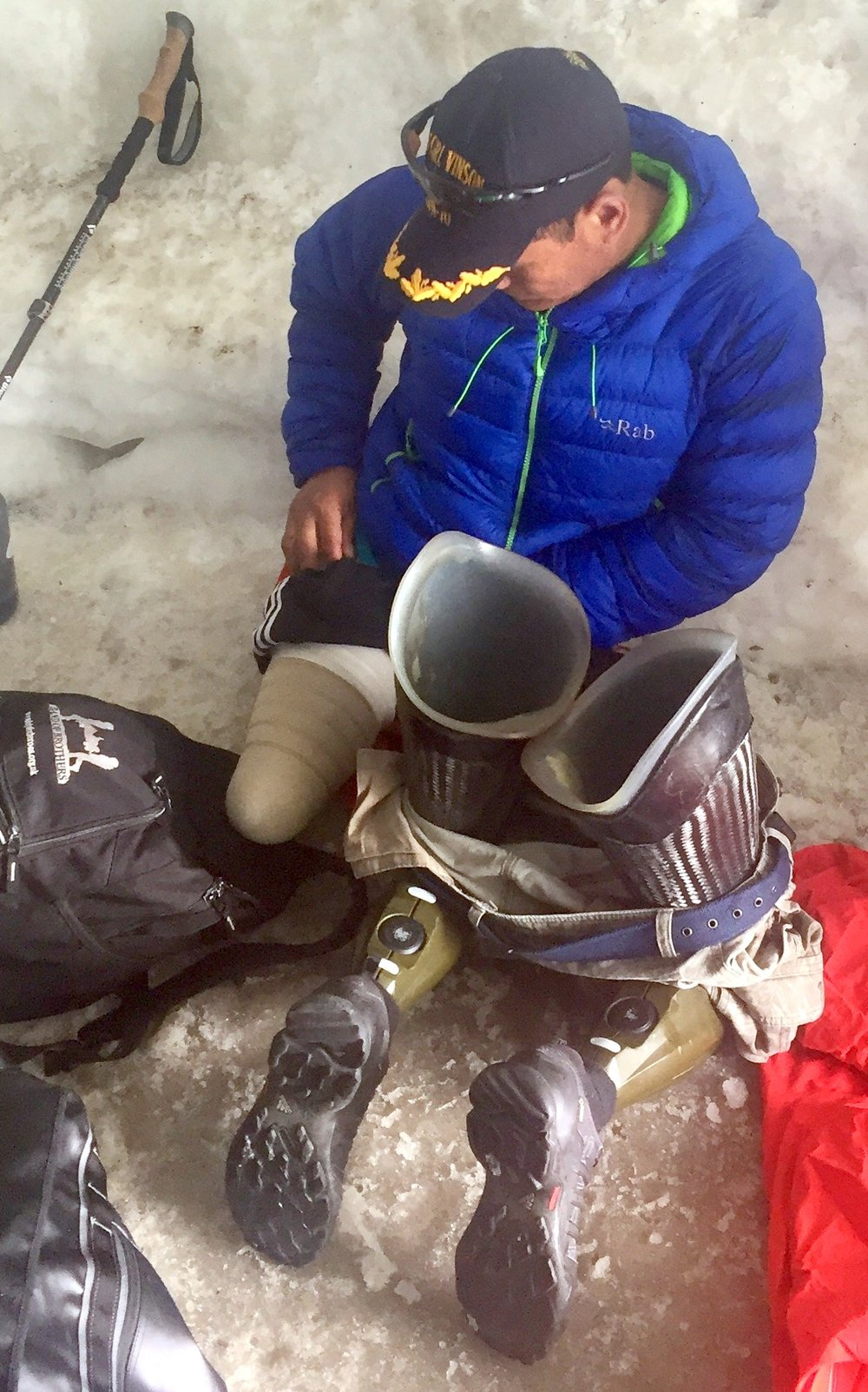 Hari inspects his sockets and residual limb in an ice cave on Mt. Blanc