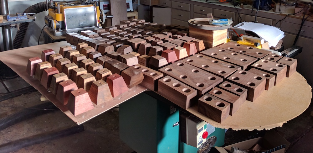 OMG! I can't do anything in the shop - the pieces have buried my table saw, and while they're being finished with tung oil, I can't use any of the other tools either since they throw off so much dust. Bakers racks - and plastic covers - have been invaluable to allow me to work on pieces at different stages.