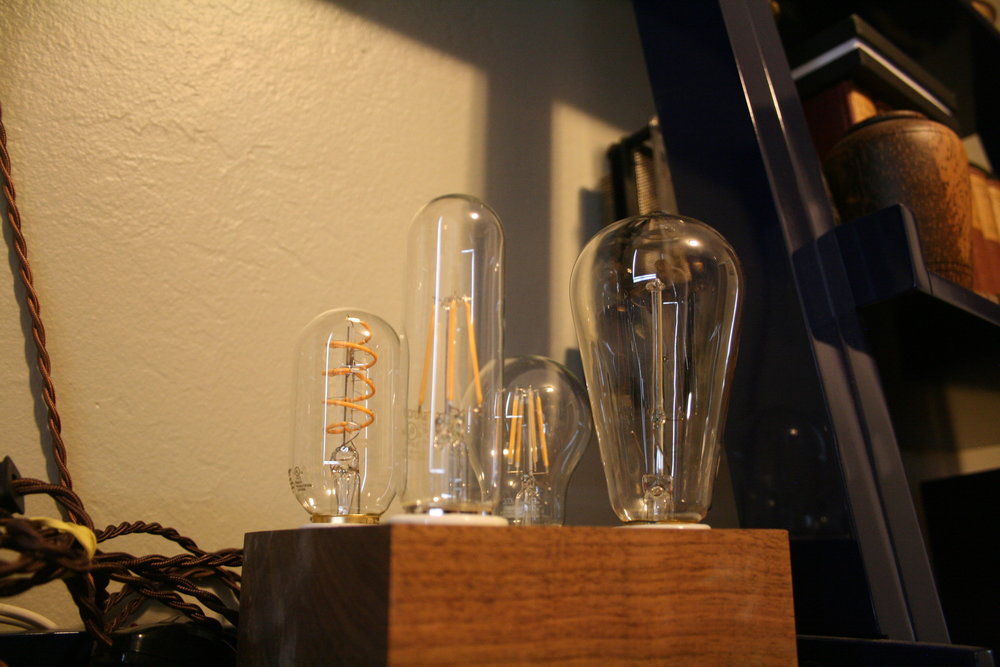 The right-most bulb is incandescent; the other three are LEDs. The difference in filaments and type is quite visible.