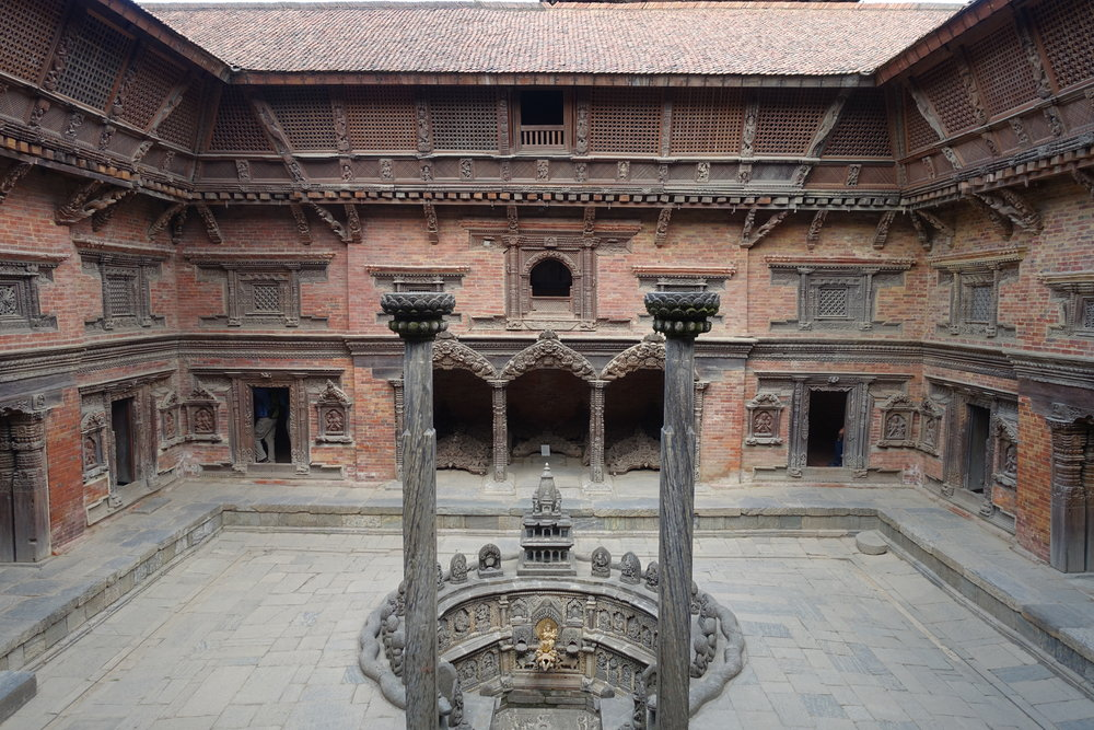 Each window and door jamb and lintel has amazingly detailed Newari carving.