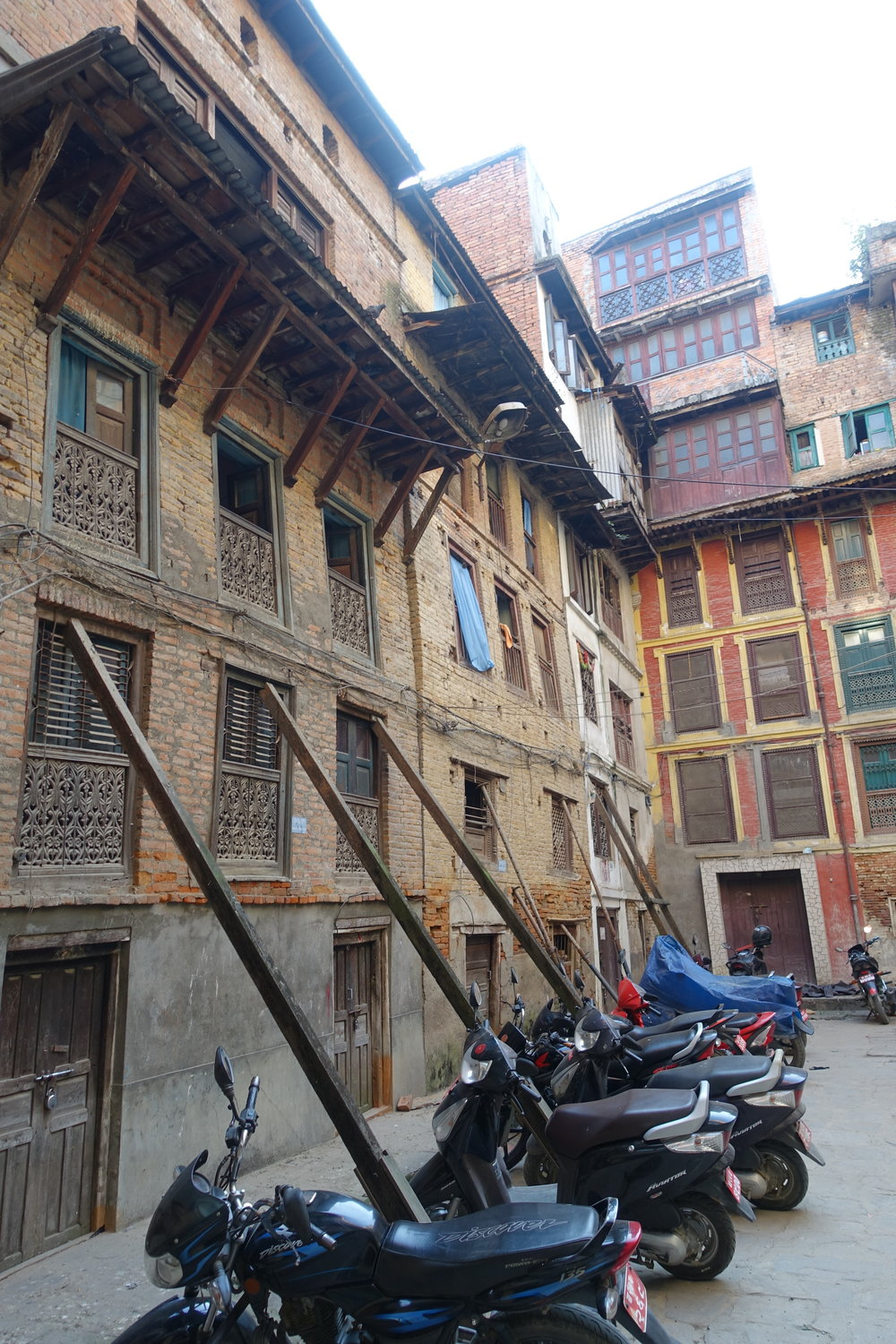 The leaning walls of many homes - and quite a few temples - are temporarily (since 2015!) reinforced