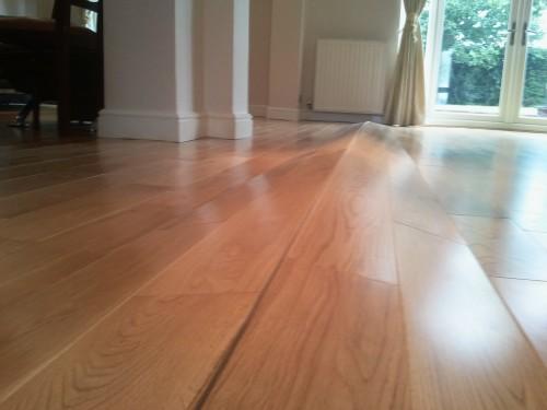 buckled-hardwood-floor.jpg