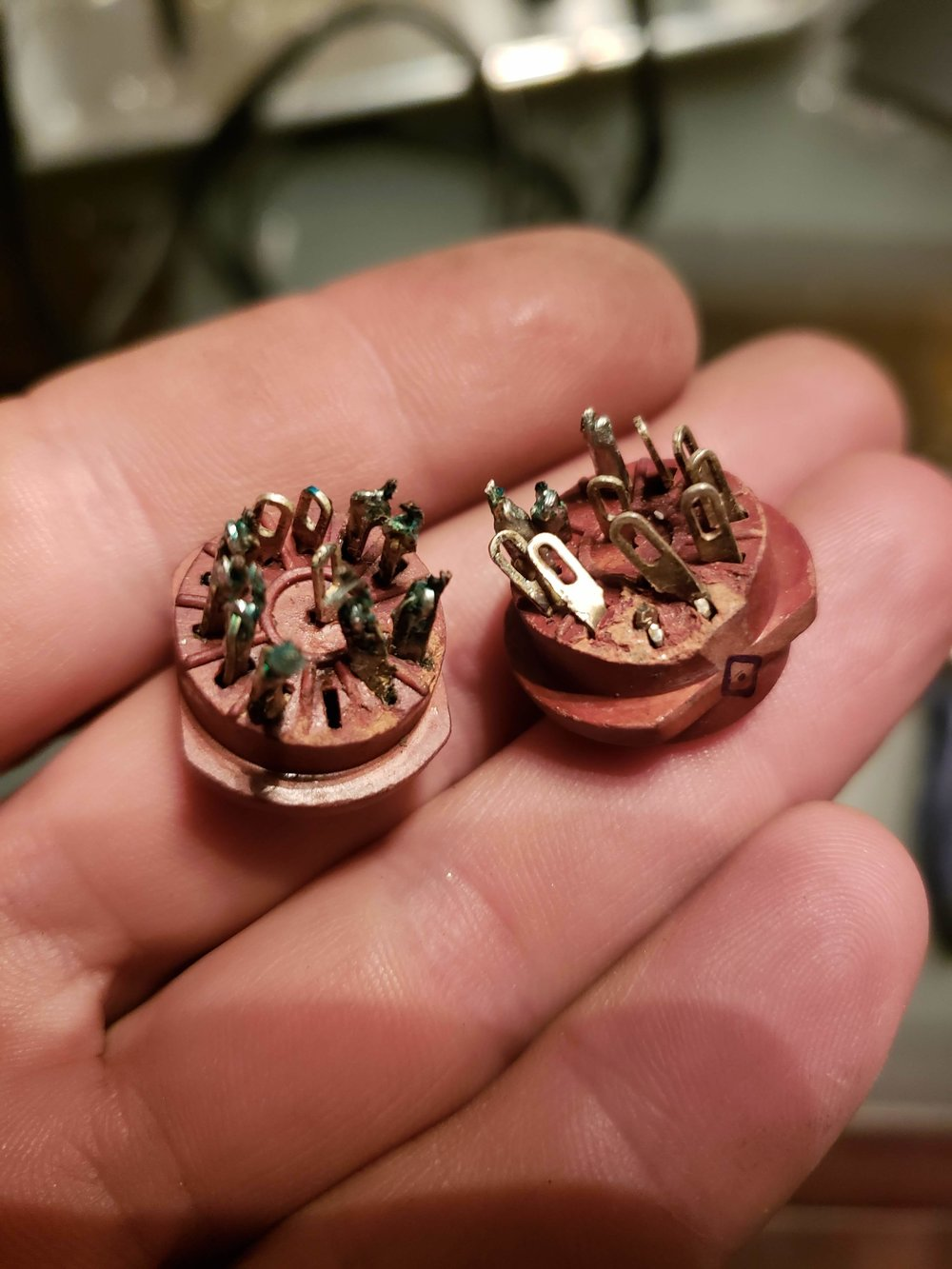 Previously-used 1960s-era Nixie tube sockets that need some desoldering (and some repair)