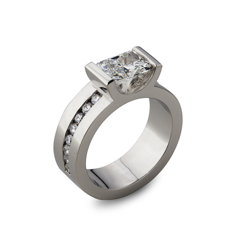Platinum engagement ring with a 1.23 Radiant Cut center diamond and sixteen 0.02 carat Round Cut side diamonds.