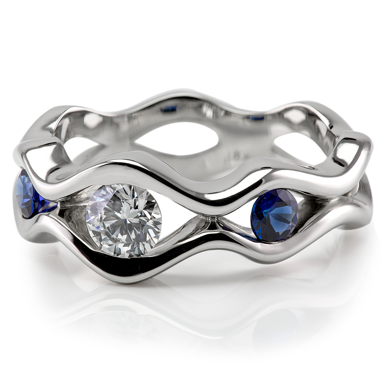 Wave sapphire and diamond engagement ring