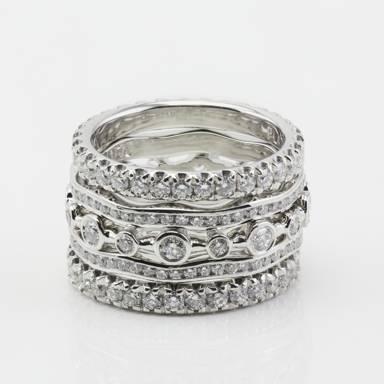 5 ring stack show's 3 different band designs made in platinum and set with diamonds